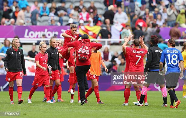 Canadian players embrace after Canada and Sweden drew at the Women's Football first round Group F Match between Canada and Sweden on Day 4 of the...