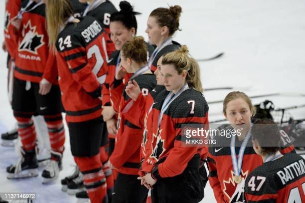Canadian players react after the IIHF Women's Ice Hockey World Championships bronze medal match between Canada and Russia in Espoo Finland on April...