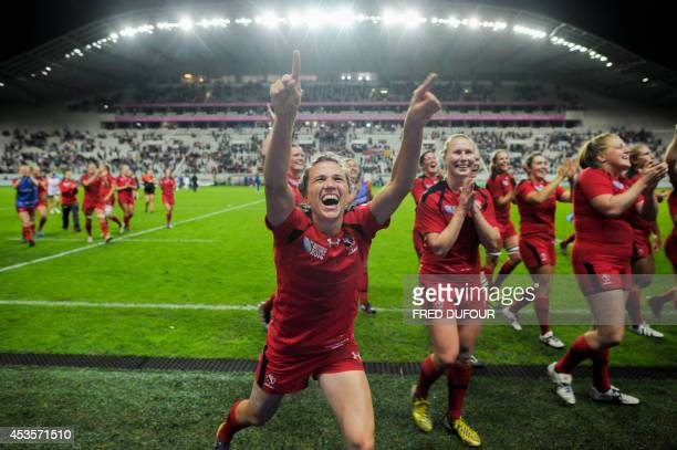 Canadian players react after winning the IRB Women's Rugby World Cup semifinal match France vs Canada at the Jean Bouin Stadium on August 13 2014 in...