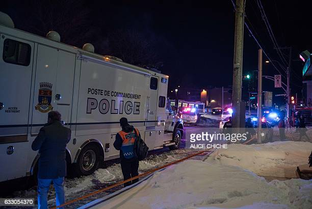 Canadian police officers respond to a shooting in a mosque at the Québec City Islamic cultural center on SainteFoy Street in Quebec city on January...