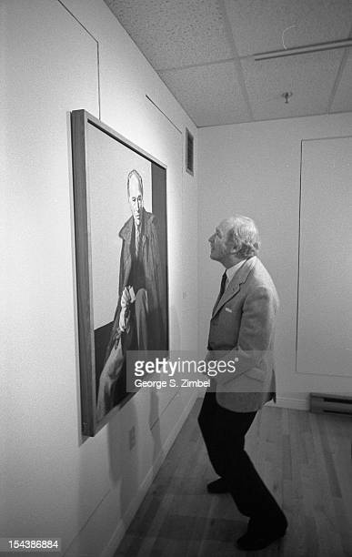Canadian politician and Prime Minister Pierre Trudeau examines a painting of himself on the wall of an unidentified gallery Canada 1970s