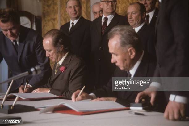 Canadian politician Pierre Trudeau and Russian politician Alexei Kosygin in the Kremlin signing Soviet-Canadian Protocol on Consultations on...