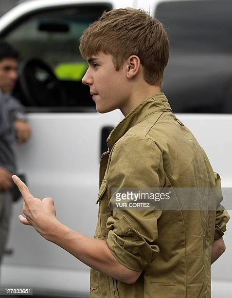 Canadian pop singer Justin Bieber gestures uon arrival for a photo opportunity before his concert as part of his 'My World Tour' at the Foro Sol...