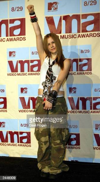 Canadian pop star Avril Lavigne arrives at the MTv video music awards 2002 at the Radio City Music Hall on August 29 2002 in New York