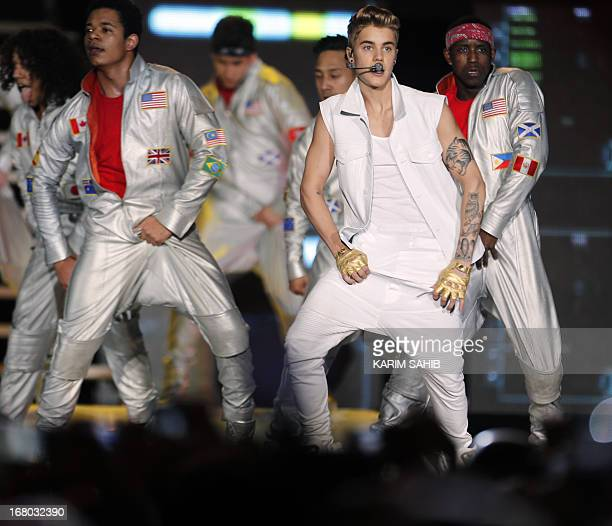 Canadian pop star Justin Bieber 19yearsold performs in front of a crowd of 15000 fans at the Sevens Stadium in Dubai on May 4 2013 This is Bieber's...