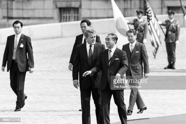 Canadian Prime Minister Brian Mulroney reviews the honour guard with Japanese Prime Minister Yasuhiro Nakasone during the welcome ceremony ahead of...