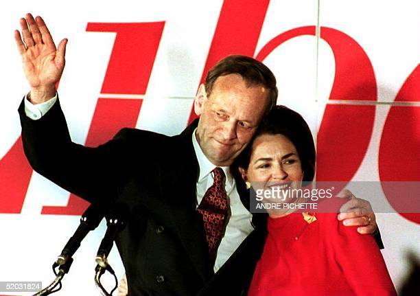 Canadian Prime Minister designate Jean Chretien and his wife Aline acknowledge supporters 26 October 1993 at the Liberal Party's headquarters in...