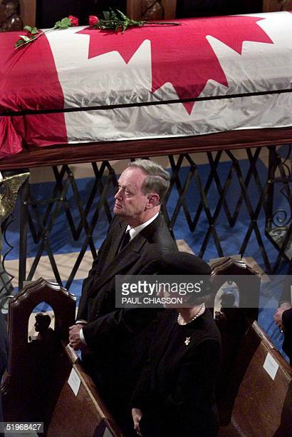 Canadian Prime Minister Jean Chretien and his wife Aline attend the state funeral for former Prime Minister Pierre Trudeau at Notre-Dame Basilica in...