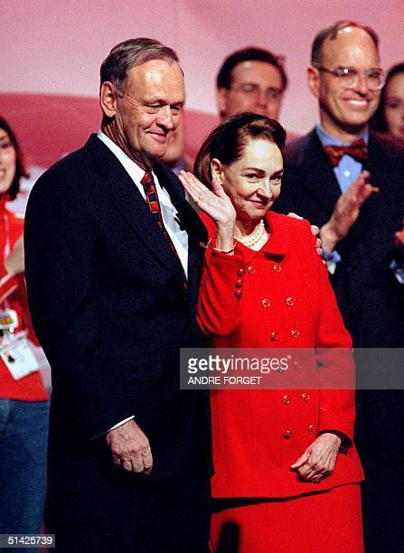 Canadian Prime Minister Jean Chretien and his wife Aline Chretien wave to the crowd of supporters during the closing ceremony of the Liberal...