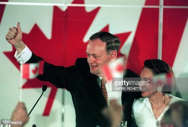 Canadian Prime Minister Jean Chretien and his wife Aline react to his governing Liberal Party re-election victory 02 June in Shawinigan, Canada....