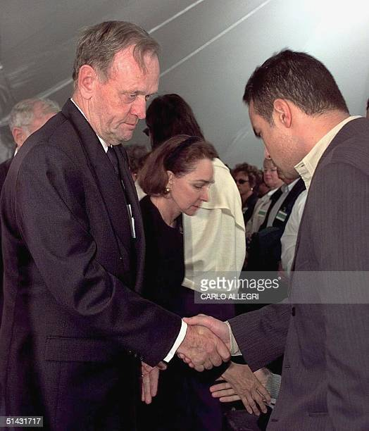 Canadian Prime Minister Jean Chretien and his wife Aline shakes hands with family members of victims of Swissair crash 111 after a memorial service...