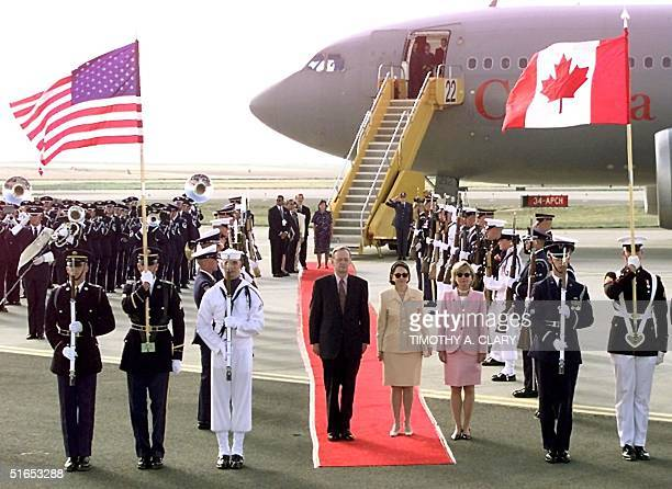 Canadian Prime Minister Jean Chretien and his wife Aline stand at attention during the playing of the national anthem of Canada after their arrival...