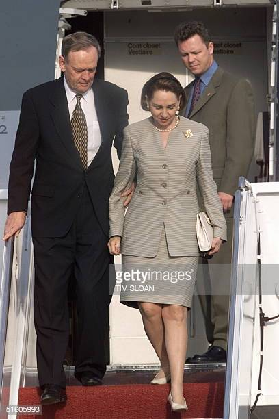 Canadian Prime Minister Jean Chretien and his wife Aline walk down the red carpeted stairs shortly after arrival, 22 April 1999, at Andrews Air Force...