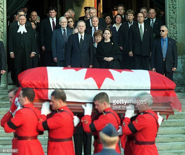 Canadian Prime Minister Jean Chretien and his wife Aline watch as Royal Canadian Mounted Police pallbearers carry the casket of former Canadian Prime...