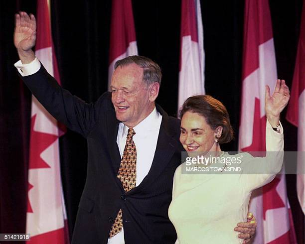 Canadian Prime Minister Jean Chretien and his wife Aline wave to supporters after he delivered an acceptance speech as his Liberal party maintained...