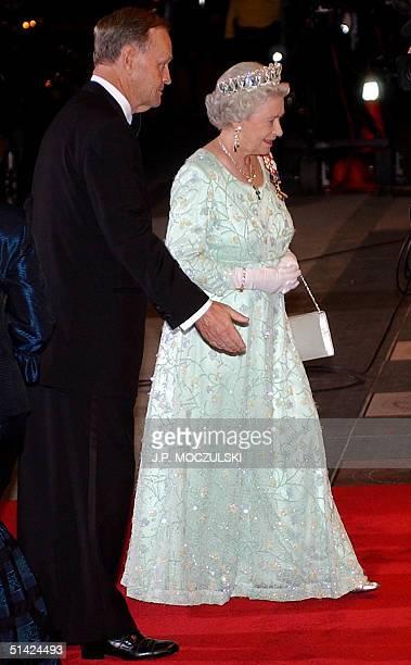 Canadian Prime Minister Jean Chretien escorts Queen Elizabeth II into an evening gala event as part of the Queen Elizabeth II Golden Jubilee...