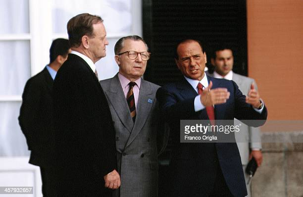 Canadian Prime Minister Jean Chretien European Commission President Jacques Delors Italian Prime Minister Silvio Berlusconi converse during the G7...