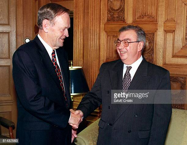Canadian Prime Minister Jean Chretien shakes hands with Russian Foreign Minister Yevgeny Primakov 30 September prior to a meeting in Chretien's...
