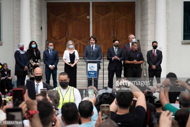Canadian Prime Minister Justin Trudeau addresses members of the Muslim community and supporters during a vigil at the London Muslim Mosque on June 8,...