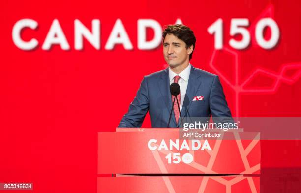 Canadian Prime Minister Justin Trudeau addresses the crowd as people celebrate Canada's 150th birthday on Parliament Hill in Ottawa on July 1 2017...