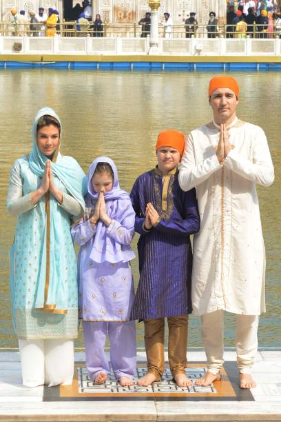 Canadian Prime Minister Justin Trudeau along with his wife Sophie Gregoire Trudeau daughter EllaGrace and son Xavier pay respect at the Sikh Golden...