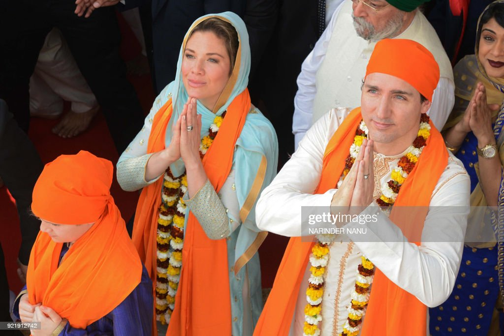 Canadian Prime Minister Justin Trudeau (R) along with his wife Sophie Gregoire (L) pay their respects at the SSikh Golden Temple in Amritsar on February 21, 2018. Trudeau and his family are on a week-long official trip to India. /