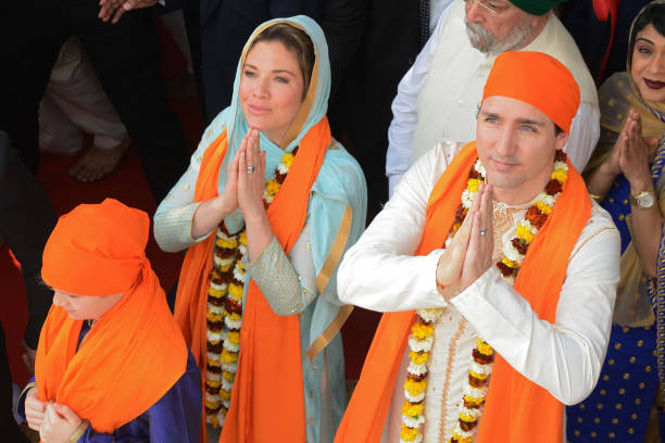 Canadian Prime Minister Justin Trudeau along with his wife Sophie Gregoire pay their respects at the SSikh Golden Temple in Amritsar on February 21...
