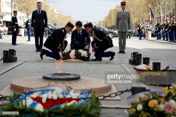 Canadian Prime Minister Justin Trudeau and French Junior Minister for Foreign Affairs JeanBaptiste Lemoyne take part in a wreath laying ceremony on...