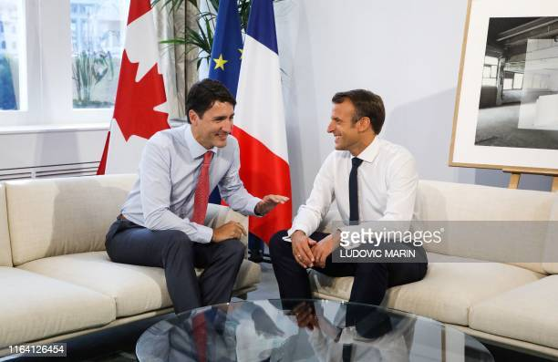 Canadian Prime Minister Justin Trudeau and French President Emmanuel Macron speak during a bilateral meeting in Biarritz southwest France on August...
