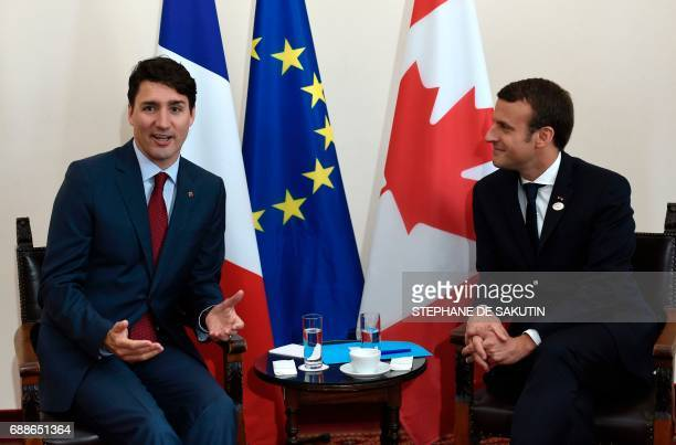 Canadian Prime Minister Justin Trudeau and French President Emmanuel Macron talk during a bilateral meeting as they attend the Summit of the Heads of...