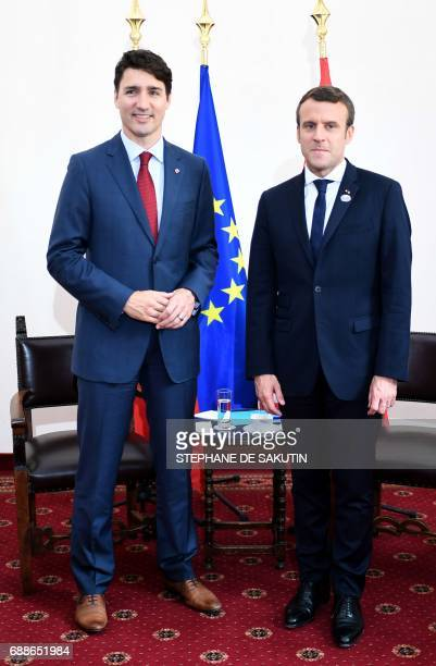 Canadian Prime Minister Justin Trudeau and French President Emmanuel Macron pose during a bilateral meeting as they attend the Summit of the Heads of...