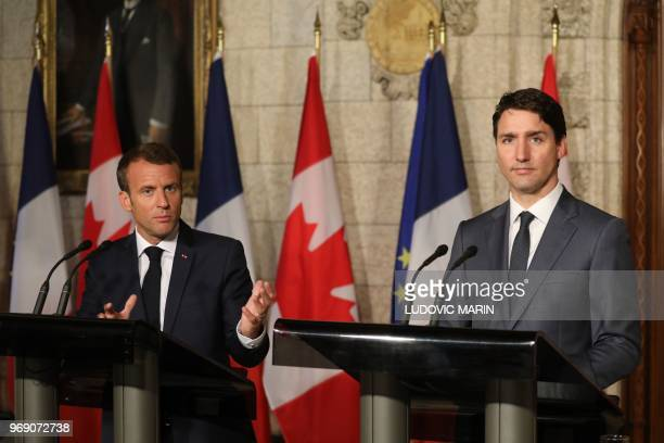 Canadian Prime Minister Justin Trudeau and French President Emmanuel Macron hold a joint press conference at Parliament on June 7 2018 in Ottawa...