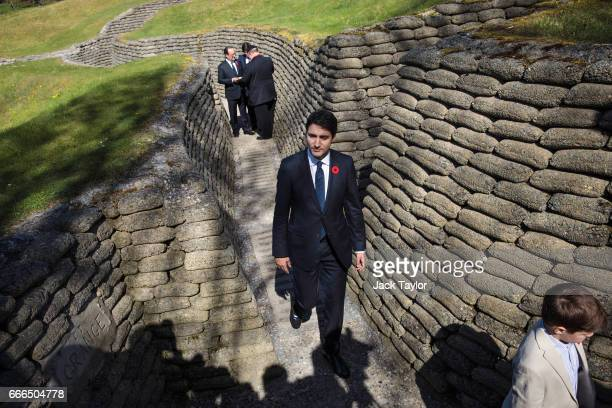 Canadian Prime Minister Justin Trudeau and his son Xavier James Trudeau, age 9 , tour the preserved trenches at Vimy Memorial Park on April 9, 2017...