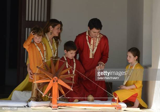 TOPSHOT Canadian Prime Minister Justin Trudeau and his wife Sophie Gregoire Trudeau sit with their daughter EllaGrace and their sons Xavier and...