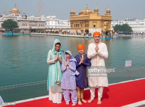 Canadian Prime Minister Justin Trudeau and his wife Sophie Gregoire Trudeau with their son Xavier and daughter EllaGrace paying obeisance on February...