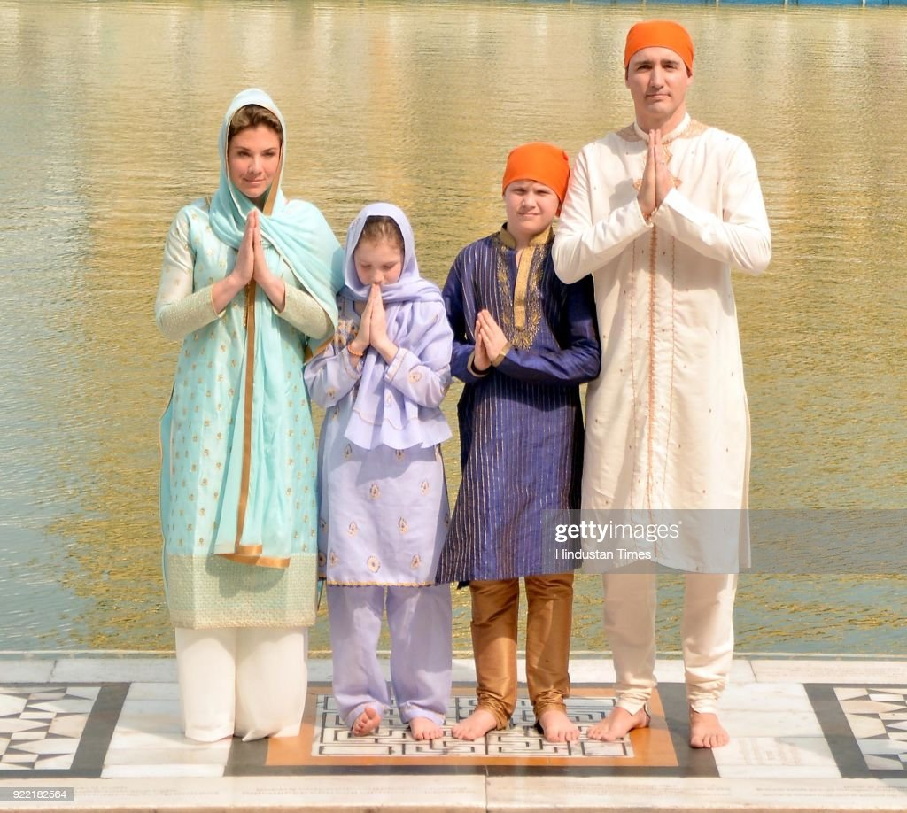 Canadian Prime Minister Justin Trudeau and his wife Sophie Gregoire Trudeau with their son Xavier and daughter Ella-Grace paying obeisance, on February 21, 2018 at Golden Temple in Amritsar, India. After offering prayers inside the temple, the Trudeau's attended the traditional langar or community meal and performed kar seva at the Golden Temple's community kitchen.