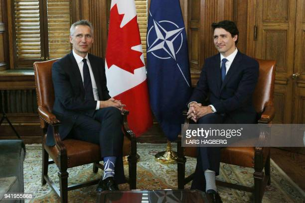 Canadian Prime Minister Justin Trudeau and NATO Secretary General Jens Stoltenberg speak during a bilateral meeting in the Prime Minister's office in...