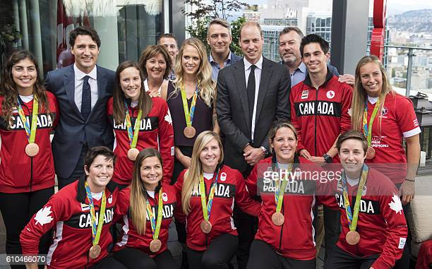 Canadian Prime Minister Justin Trudeau and Prince William Duke of Cambridge pose with members of the Canadian Olympic team at the Young Canadians...