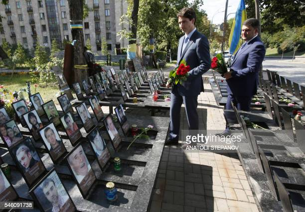 Canadian Prime Minister Justin Trudeau and Ukrainian Prime Minister Volodymyr Groysman lay flowers at the monument to the Heavenly Hundred in memory...
