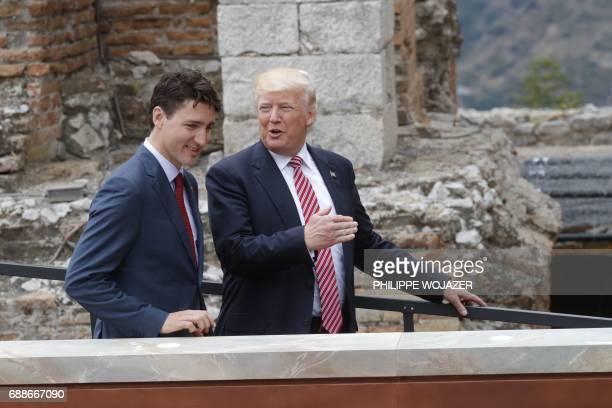 Canadian Prime Minister Justin Trudeau and US President Donald Trump talk as they attend the Summit of the Heads of State and of Government of the G7...