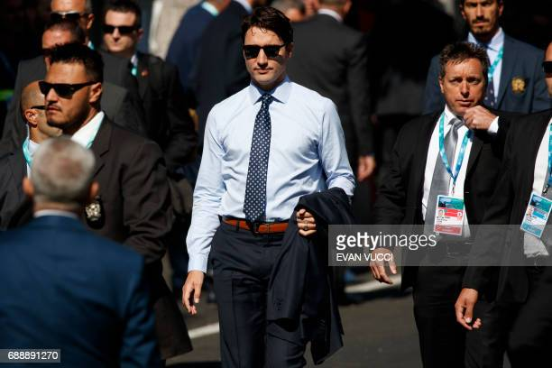 TOPSHOT Canadian Prime Minister Justin Trudeau arrives at the Hotel San Domenico for a working session with outreach countries and international...