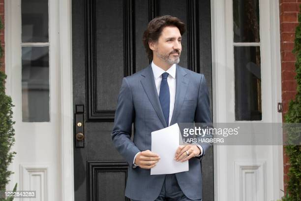 Canadian Prime Minister Justin Trudeau arrives for his daily coronavirus, COVID-19 briefing at Rideau Cottage in Ottawa, Ontario, on June 25, 2020.