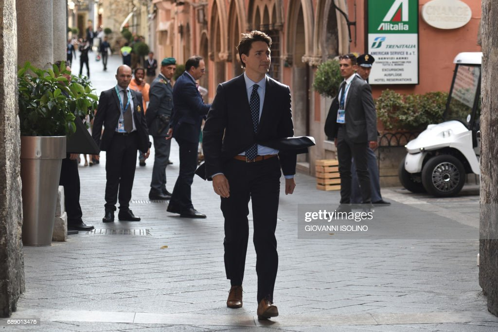 Canadian Prime Minister Justin Trudeau arrives to give a press conference at the end of a G7 Summit of Heads of State and of Government, on May 27, 2017 in Taormina, Sicily. /