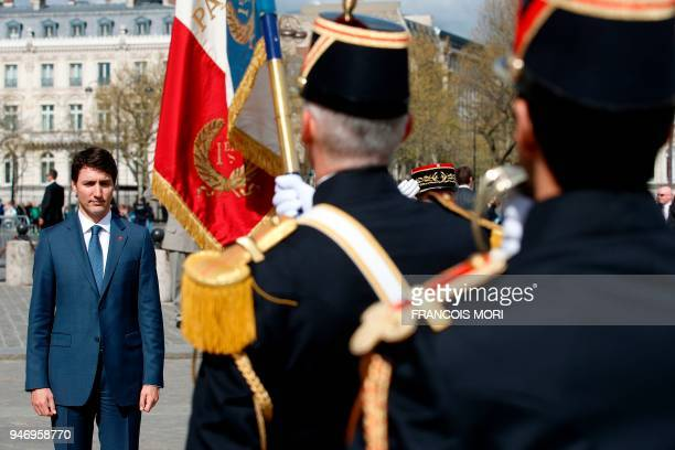 Canadian Prime Minister Justin Trudeau attends a wreath laying ceremony on the Tomb of the Unknown Soldier at the Arc de Triomphe in Paris on April...