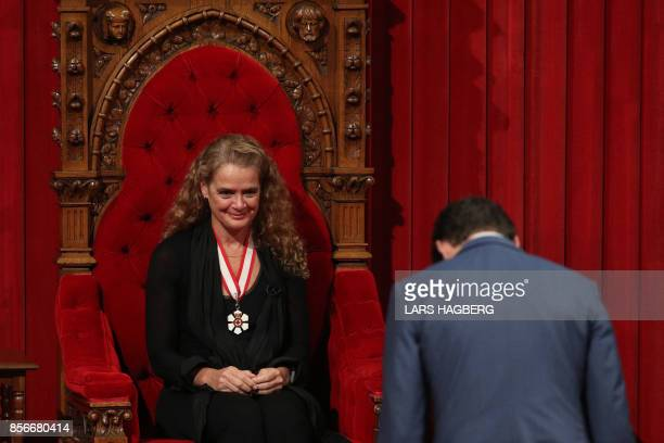 Canadian Prime Minister Justin Trudeau bowes to the new the Governor general Julie Payette at the senate in Ottawa, Ontario, October 2, 2017. - The...