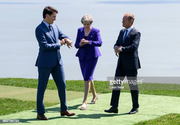 Canadian Prime Minister Justin Trudeau British Prime Minister Theresa May and President of the European Council Donald Tusk check their watches...