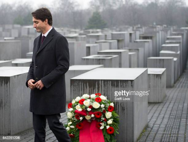Canadian Prime Minister Justin Trudeau carries a wreath to a stellae at the Memorial to the Murdered Jews of Europe also called the Holocaust...