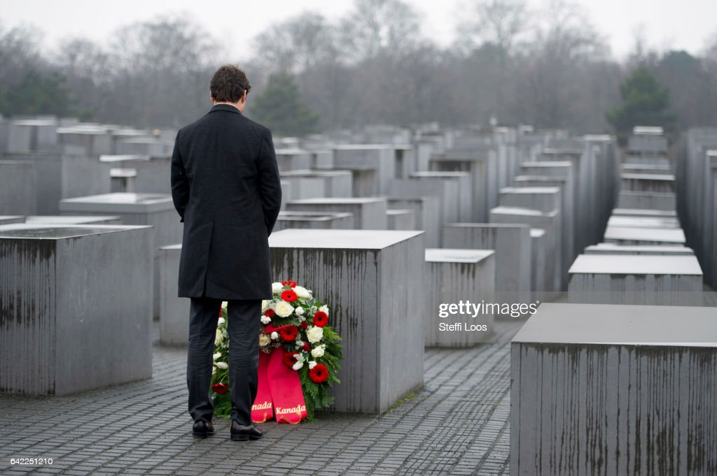 Canadian Prime Minister Justin Trudeau carries a wreath to a stellae at the Memorial to the Murdered Jews of Europe, also called the Holocaust Memorial on February 17, 2017 in Berlin, Germany. Canada's Prime Minister Justin Trudeau is visiting Germany for his first official visit after delivering a speech during a plenary session at the European Parliament in Strasbourg, France consisting of a pro-trade pitch to a conflicted Europe.