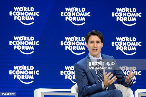 Canadian Prime Minister Justin Trudeau delivers a speech during the World Economic Forum 2018 annual meeting on January 23 2018 in Davos eastern...