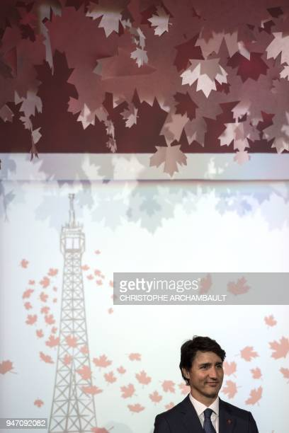 Canadian Prime Minister Justin Trudeau delivers a speech during the inauguration of the new Canadian Embassy in Paris on April 16 as part of his...